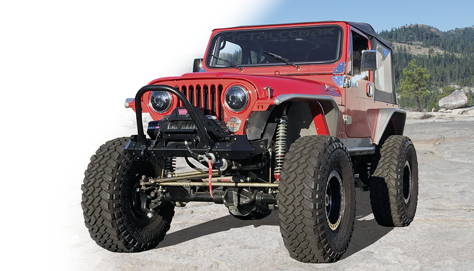 Red Jeep CJ on granite rock