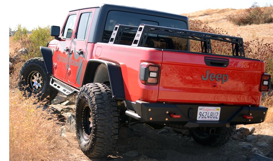 red MetalCloak Jeep JT Gladiator on banked dirt trail