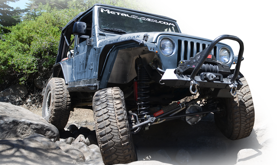 Gray Jeep TJ with MetalCloak gear crawling over rocks